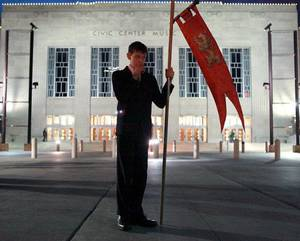 photo - Protestor Anthony Slobodnik, a member of America Needs Fatima, holds a flag outside a satanic demonstration by members of the Church of the IV Princes at the Civic Center Music Hall in downtown Oklahoma City on Thursday, Oct. 21, 2010. Photo by John Clanton, The Oklahoman ORG XMIT: KOD