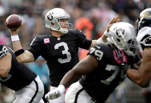 Photo -   Oakland Raiders quarterback Carson Palmer (3) passes against the Jacksonville Jaguars during the first quarter of an NFL football game, Sunday, Oct. 21, 2012, in Oakland, Calif. (AP Photo/Marcio Jose Sanchez)