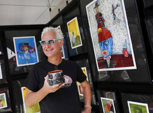 "Photo -  Oklahoma City artist Mike ""Kemper""with some of the colorful art displayed in his tent at at the 2014 Festival of the Arts in downtown Oklahoma City l on Wednesday. Photo by Jim Beckel, The Oklahoman  <strong>Jim Beckel -  THE OKLAHOMAN </strong>"