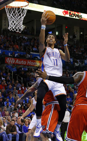 Photo - Oklahoma City's Jeremy Lamb (11) goes to the basket during an NBA basketball game between the Oklahoma City Thunder and The Milwaukee Bucks at Chesapeake Energy Arena in Oklahoma City, Saturday, Jan. 11, 2014.  Oklahoma City won 101-85. Photo by Bryan Terry, The Oklahoman