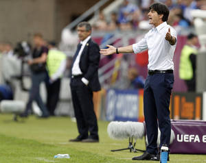 photo -   Germany head coach Joachim Loew reacts during the Euro 2012 soccer championship quarterfinal match between Germany and Greece in Gdansk, Poland, Friday, June 22, 2012. (AP Photo/Jon Super)