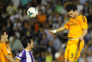 Photo - Real Madrid's Portuguese defender Pepe, right,  jumps for the ball during a Spanish La Liga soccer match against Real Valladolid,  at the Jose Zorrilla stadium in Valladolid, Spain, Wednesday, May 7, 2014. (AP Photo/Israel L. Murillo)