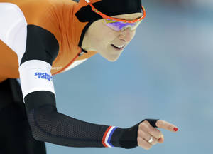 Photo - Silver medallist Ireen Wust of the Netherlands competes in the women's 1,500-meter speedskating race at the Adler Arena Skating Center during the 2014 Winter Olympics in Sochi, Russia, Sunday, Feb. 16, 2014. (AP Photo/Patrick Semansky)