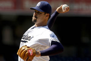 photo -   San Diego Padres starting pitcher Jeff Suppan throws to the Milwaukee Brewers during the first inning of a baseball game, Wednesday, May 2, 2012, in San Diego. (AP Photo/Lenny Ignelzi)