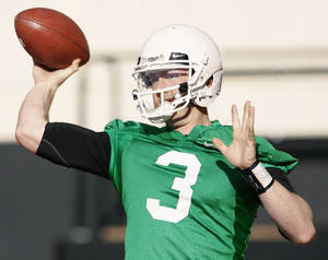 "Photo - OSU quarterback Brandon Weeden will be the ""point guard"" in the new offense, which has been described as ""basketball on grass.""  PHOTO BY NATE BILLINGS, THE OKLAHOMAN"