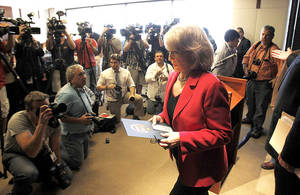 Photo - Gov. Jan Brewer leaves a news conference Monday after announcing Arizona will appeal  a lower court ruling  on its immigration enforcement law. AP Photo