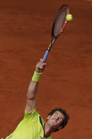 Photo - Andy Murray from Britain serves during a Madrid Open tennis tournament match against Santiago Giraldo from Colombia in Madrid, Spain, Thursday, May 8, 2014. (AP Photo/Andres Kudacki)