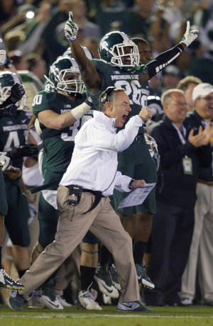 Photo - Michigan coach Mark Dantonio reacts to a turnover by Stanford during the second half of the Rose Bowl NCAA college football game Wednesday, Jan. 1, 2014, in Pasadena, Calif. Michigan State won 24-20. (AP Photo/Mark J. Terrill)
