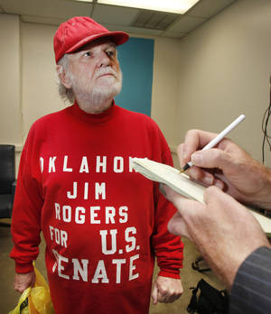photo - U.S. Senate candidate Jim Rogers talks with reporters after filing for office at the State Capitol in Oklahoma City, Oklahoma June 8 , 2010. Photo by Steve Gooch, The Oklahoman