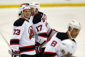 photo - New Jersey Devils center David Clarkson (23) smiles during a scrimmage against the Albany Devils, the team's AHL farm team, Wednesday, Jan. 16, 2013, in Newark, N.J. (AP Photo/Julio Cortez)