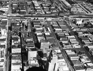 Photo - Aerial view of downtown Oklahoma City in 1953 looking east/southeast from about Robert S. Kerr (NW 3) and Harvey. Four major east-west streets shown are, from left, Robert S. Kerr (NW 3), Sheridan, California and Reno.  FILE PHOTO <strong>Jim Lucas - The Daily Oklahoman</strong>