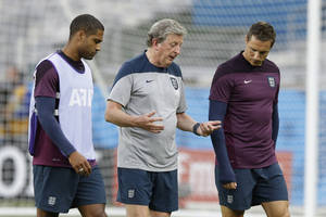 Photo - England's manager Roy Hodgson, center, speaks to defenders Glen John, left, and Phil Jagielka away from the rest of the squad during an official training session the day before the group D World Cup soccer match between Costa Rica and England at the Mineirao Stadium in Belo Horizonte, Brazil, Monday, June 23, 2014. (AP Photo/Matt Dunham)