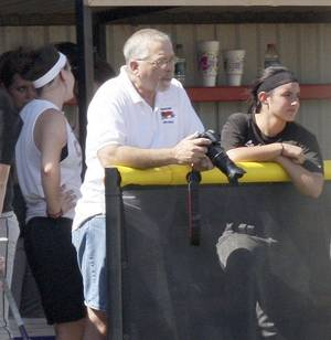 Photo - Casey Paxton of the Mangum Star-News, with camera, is shown recently at the Mangum Lady Tiger fast pitch softball district tournament. Casey and wife Karla Paxton, not pictured, are the editors and publishers of the Mangum Star-News. Provided
