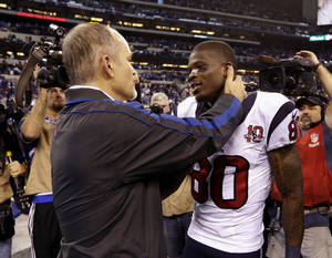 photo - Indianapolis Colts head coach Chuck Pagano, left, talks to Houston Texans' Andre Johnson following an NFL football game, Sunday, Dec. 30, 2012, in Indianapolis. The Colts won the game 28-16. (AP Photo/Michael Conroy)