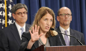 Photo - Health and Human Services Secretary Sylvia Burwell, center, flanked by Treasury Secretary and Managing Trustee Jacob J. Lew, left, and Labor Secretary Thomas E. Perez, speaks at a news conference at the Treasury Department in Washington, Monday, July 28, 2014, to discuss the release of the annual Trustees Reports. (AP Photo/Susan Walsh)