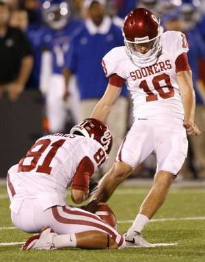Photo - Oklahoma's Michael Hunnicutt (18) kicks a field goal during the college football game between the University of Oklahoma Sooners (OU) and the University of Kansas Jayhawks (KU) at Memorial Stadium in Lawrence, Kansas, Sunday Oct. 16, 2011. Photo by Bryan Terry, The Oklahoman <strong>BRYAN TERRY</strong>