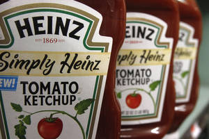photo - FILE - In this March 2, 2011 file photo, Heinz ketchup is seen on the shelf of a market in Barre, Vt. H.J. Heinz Co. says it agreed to be acquired by an investment consortium including billionaire investor Warren Buffett in a deal valued at $28 billion. (AP Photo/Toby Talbot, File)