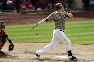 photo -   San Diego Padres' Chase Headley hits a grand slam during the seventh inning against the Arizona Diamondbacks in their baseball game, Sunday, Sept. 9, 2012, in San Diego. Padres' Chris Denorfia, Carlos Quentin and Logan Forsythe scored on the hit. (AP Photo/Gregory Bull)