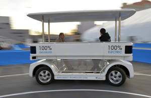 Photo - Induct demonstrates their new Navia driverless shuttle at the International Consumer Electronics Show, Monday, Jan. 6, 2014, in Las Vegas. (AP Photo/Jack Dempsey)