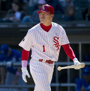 Photo -   Chicago White Sox's Kosuke Fukudome, of Japan, walks back to the dugout after striking out during the eighth inning of a baseball game against the Kansas City Royals, Sunday, May 13, 2012 in Chicago. The Royals won 9-1. (AP Photo/Brian Kersey)