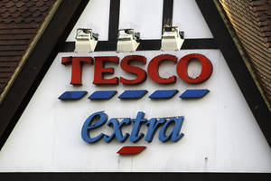 "Photo - A sign of Tesco supermarket is seen at a branch in Purley, south London, Wednesday, Jan. 16, 2013. The Irish food safety watchdog said Tuesday that it had discovered traces of horse and pig DNA in burger products sold by some of the country's biggest supermarkets. Tesco that authorities said was made of roughly 30 percent horse. Tesco, the country's biggest supermarket chain, took out full-page newspaper ads Thursday Jan. 17, 2013  to apologize for an unwanted ingredient in some of its hamburgers: horsemeat. Ten million burgers have been taken off shop shelves after the revelation that beef products from three companies in Ireland and Britain contained horse DNA. Most had only small traces, but one type of burger sold by Tesco was 29 percent horse. The contrite grocer told customers that ""we and our supplier have let you down and we apologize."" (AP Photo/Sang Tan)"