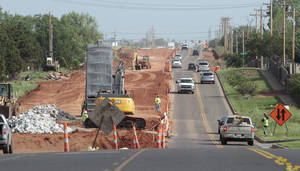 Photo - Work continues on the $16.1 million road-widening project along Covell Road and Kelly Avenue. An asphalt base is expected to be poured this week if the weather is agreeable. PHOTO BY DAVID MCDANIEL, THE OKLAHOMAN