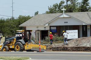 Photo - Workers widen the roadway in front of Mission Norman at 2525 E Lindsey St. The mission is getting ready to build a new worship center and transitional housing for the homeless. PHOTO BY STEVE SISNEY, THE OKLAHOMAN