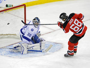 Photo - New Jersey Devils' Jaromir Jagr (68), of the Czech Republic, scores an unassisted goal against Tampa Bay Lightning goaltender Ben Bishop during the second period of an NHL hockey game Tuesday, Oct. 29, 2013, in Newark, N.J. (AP Photo/Bill Kostroun)