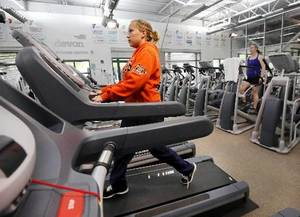 Photo - Roxy Dixon of Oklahoma City, exercises on a treadmill at the downtown YMCA on Thursday, May 2, 2013. Oklahoma was included in a recent CDC report on aerobic exercise and muscle strengthening. Photo by Jim Beckel, The Oklahoman.
