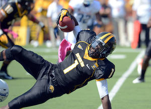 Photo -   Southern Mississippi wide receiver Tracy Lampley (1) gets tackled on a kickoff return against Boise State during the second quarter of an NCAA college football game in Hattiesburg, Miss., Saturday, Oct. 6, 2012. (AP Photo/Steve Coleman)