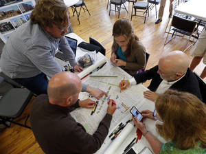 Photo -  Urban design experts, clockwise from left, Chris Janson, Cailin Shannon, Geoff Ferrell, Mary Madden and Daniel Parolek hold a brainstorming session as part of a weeklong design workshop in Norman. PHOTO BY STEVE SISNEY, THE OKLAHOMAN  <strong>STEVE SISNEY -   </strong>