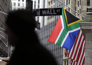 Photo - The flags of South Africa and United States fly at half staff on the facade of the New York Stock Exchange, Friday, Dec. 6, 2013. Nelson Mandela, South Africa's first black president, died Thursday after a long illness. He was 95. (AP Photo/Richard Drew)