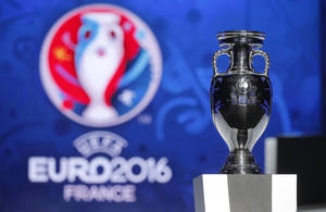 Photo - The UEFA EURO 2016 trophy is displayed during the qualifying draw ceremony at the Acropolis Convention Centre in Nice, southeastern France, Sunday, Feb 23, 2014.  (AP Photo/Lionel Cironneau)