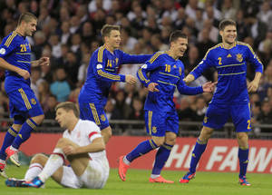 Photo -   Ukraine's Levgenii Konoplianka, second right, celebrates his goal against England with teammates during their group H 2014 World Cup qualifying soccer match at Wembley Stadium, London, Tuesday, Sept. 11, 2012. (AP Photo/Sang Tan)