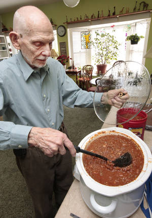 Photo - Warren Smith spent a day this week making three gallons of chili for a fundraiser for the Edmond Evening Lions Club. The club is celebrating its 50th anniversary. PHOTO BY DAVID MCDANIEL, THE OKLAHOMAN