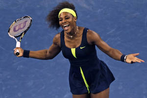 Photo -   Serena Williams reacts at the net after missing a return against Ana Ivanovic, of Serbia, during the quarterfinal round of play at the U.S. Open tennis tournament, Wednesday, Sept. 5, 2012, in New York. (AP Photo/Charles Krupa)