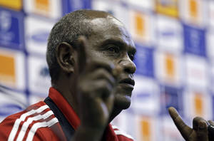 photo - Ethiopia's head coach Sewnet Bishaw gestures during a news conference at the Royal Bafokeng stadium in Rustenburg, South Africa, Monday, Jan. 28, 2013. Ethiopia will play Nigeria Tuesday in a African Cup of Nations group C match. The two other teams in group C are Burkina Faso and Zambia. (AP Photo/Armando Franca)