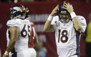 Photo -   Denver Broncos quarterback Peyton Manning (18) reacts after being sacked by the Atlanta Falcons during the first half of an NFL football game, Monday, Sept. 17, 2012, in Atlanta. (AP Photo/John Bazemore)