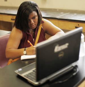 photo - Dominique Bradford, 17, studies in a classroom at Northwest Classen High School in Oklahoma City, Wednesday, June 20, 2012.  Oklahoma City Public Schools hosted a two-week boot camp for seniors still trying to pass state-mandated exams that are required this year before students can receive their high school diplomas.  Photo by Garett Fisbeck, The Oklahoman