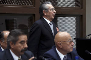 photo - Guatemala's former dictator Jose Efrain Rios Montt, top, attends his hearing in Guatemala City, Monday, Jan. 28, 2013. Rios Montt, a former U.S.-backed dictator who presided over one of the bloodiest periods of Guatemala's civil war, will stand trial on charges he ordered the murder, torture and displacement of thousands of Mayan Indians, a judge ruled Monday. (AP Photo/Moises Castillo)