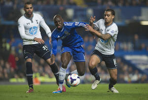 Photo - Chelsea's Demba Ba, center, fights for the ball with Tottenham Hotspur's Kyle Naughton and Sandro, left, during their English Premier League soccer match, at the Stamford Bridge Stadium in London, Saturday March 8, 2014. (AP Photo/Bogdan Maran)