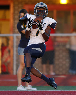 Photo - Southmoore's Jalen Adams (7) makes a touchdown catch during a high school football game between Carl Albert and Southmoore in Midwest City, Okla., Friday, Aug. 31, 2012. Photo by Nate Billings, The Oklahoman