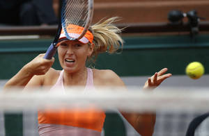Photo - Russia's Maria Sharapova returns the ball to Argentina's Paula Ormaechea during the third round match of  the French Open tennis tournament at the Roland Garros stadium, in Paris, France, Friday, May 30, 2014. (AP Photo/Michel Euler)