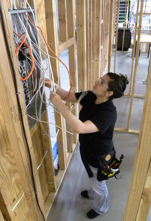 photo - Erica McElyea is nearing completion of career training in Electrical Trades Technology. She likes the challenge of being the only female in her class and wants to go to work in the homebuilding industry.  PHOTO PROVIDED