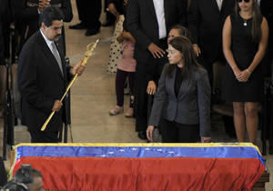 photo - In this image released by the office of Mexico's Presidencia, Venezuela's Vice President Nicolas Maduro, left, holds a replica of Simon Bolivar's sword next to the flag-draped coffin of Venezuela's late President Hugo Chavez during the funeral ceremony at the military academy in Caracas, Venezuela, Friday, March 8, 2013. Chavez died on March 5 after a nearly two-year bout with cancer. (AP Photo/Presidencia de la Republica de Mexico, Daniel Aguilar)
