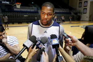 Photo - Oklahoma City's Kevin Durant talks with the media before a Thunder practice at Rice University in Houston, Texas, Sunday., April 28, 2013. Photo by Bryan Terry, The Oklahoman