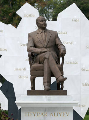 Photo -   A life-size bronze statue of late Azerbaijan president Geidar Aliev is seen on Mexico City's main boulevard, Reforma Avenue, Monday, Oct. 1, 2012. Mexican protesters say that a man who ruled such a far-away land with such a heavy hand shouldn't be on a boulevard decorated with statues to Mexican and foreign heroes. (AP Photo/Eduardo Verdugo)