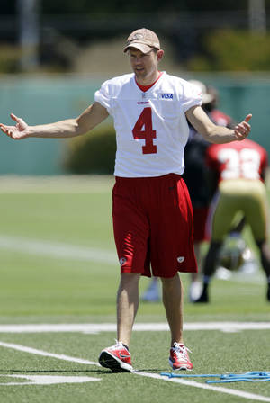 Photo -   San Francisco 49ers punter Andy Lee gestures to teammates during NFL football practice at the team's training facility in Santa Clara, Calif., Wednesday, May 23, 2012. Lee received a six-year contract with the 49ers on Wednesday. (AP Photo/Paul Sakuma)