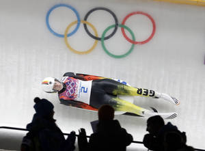 Photo - Natalie Geisenberger of Germany speeds down the track in her second run during the women's singles luge competition at the 2014 Winter Olympics, Monday, Feb. 10, 2014, in Krasnaya Polyana, Russia. (AP Photo/Natacha Pisarenko)