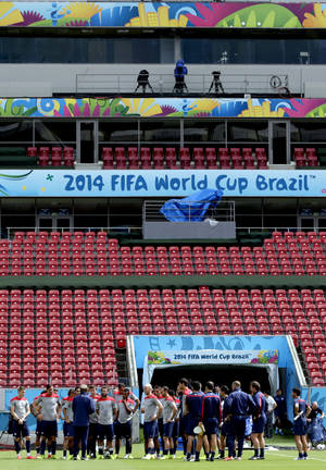 Photo - United States players congregate on the pitch during a training session in Recife, Brazil, Wednesday, June 25, 2014. The U.S. will play Germany in group G of the 2014 soccer World Cup on June 26. (AP Photo/Julio Cortez)